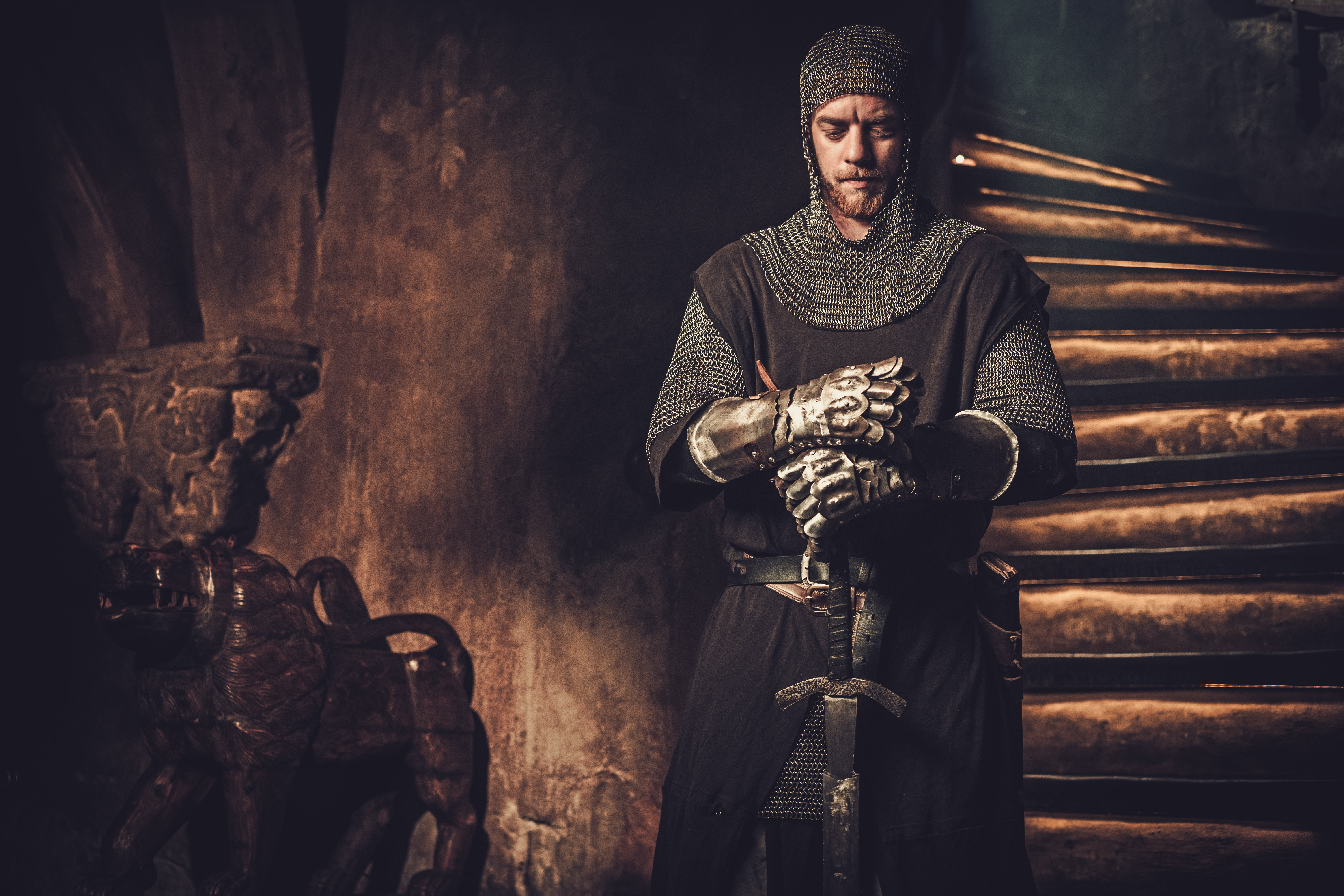 Medieval knight in ancient castle interior